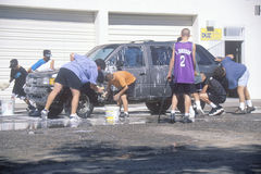 Students washing cars for a school fundraiser, NM Royalty Free Stock Image