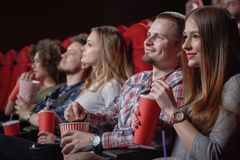 Students watching movie in modern cinema hall royalty free stock photos