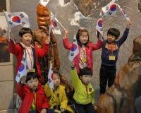 Students wave Korean flags at War Memorial of Korea, Jeonjaeng ginyeomgwan, Yongsan-dong, Seoul, South Korea  - NOVEMBER 2013 Stock Images