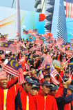 Students waving Malaysia flags during National Day Royalty Free Stock Images