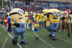Students wear minions custume in Christmas Fair 2015. Bangkok, Thailand - December, 23 :Parents and students of St. Gabriel College parade at the school stadium stock photos