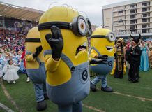 Students wear minions custume in Christmas Fair 2015. Bangkok, Thailand - December, 23 :Parents and students of St. Gabriel College parade at the school stadium stock image