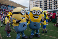 Students wear minions custume in Christmas Fair 2015. Bangkok, Thailand - December, 23 :Parents and students of St. Gabriel College parade at the school stadium royalty free stock photography