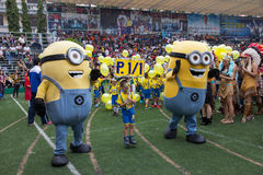 Students wear minions custume in Christmas Fair 2015. Bangkok, Thailand - December, 23 :Parents and students of St. Gabriel College parade at the school stadium stock photography