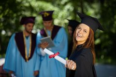 Students wearing graduation gowns and caps Royalty Free Stock Photography