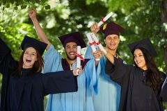 Students wearing graduation gowns and caps Royalty Free Stock Image