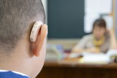 Students who wear hearing aids to increase hearing efficiency royalty free stock photos