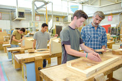 Students in woodwork class. Students in a woodwork class royalty free stock photo