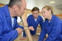 Students in woodwork class. Teacher Royalty Free Stock Images