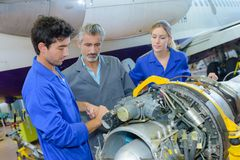 Students working on aircraft component. Aviation royalty free stock photos