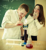 Students working in chemistry laboratory at the classroom. Students working in chemistry laboratory with liquid formula at the classroom Royalty Free Stock Images