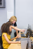 Students working on computer in classroom Royalty Free Stock Photos
