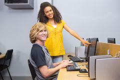 Students working on computer in classroom Stock Image