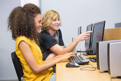 Students working on computer in classroom Stock Photography