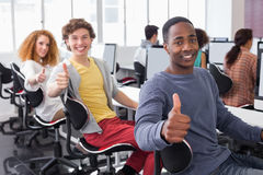Students working in computer room Royalty Free Stock Photos