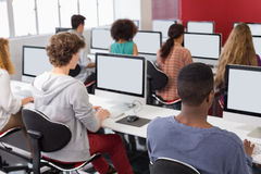 Students working in computer room Royalty Free Stock Images