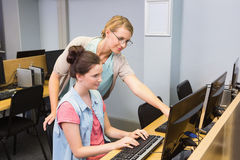 Students working on computer together Royalty Free Stock Image