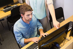 Students working on computer together Stock Images