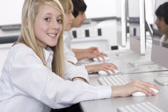 Students working on computers in school computer lab Royalty Free Stock Photography