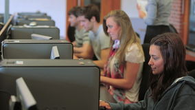 Students working concentrated on the computer Stock Photo