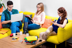 Students working on the couch Royalty Free Stock Photos
