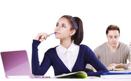 Students working at desks Stock Images