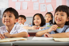 Students Working At Desks In Chinese School Royalty Free Stock Photos
