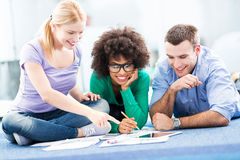 Students working on floor Stock Photo