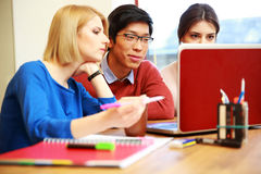 Students working on laptop together. Smiling students working on laptop together royalty free stock photo