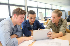 Students working on tablet at school royalty free stock photo