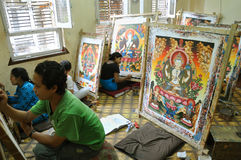 Students working in thangka painting school in Nepal Stock Image