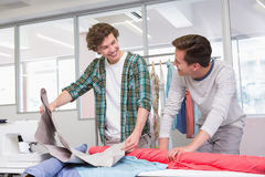 Students working together with a fabric Stock Photos