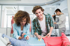 Students working together with a fabric Royalty Free Stock Photo