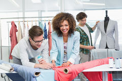Students working together with a fabric Royalty Free Stock Image
