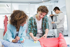 Students working together with a fabric Royalty Free Stock Photos