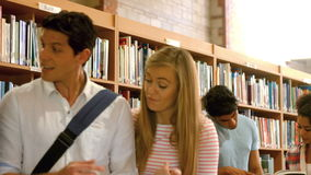 Students working together in the library. In college stock video footage
