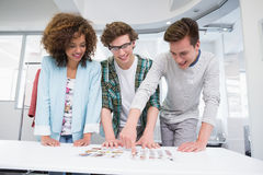 Students working together with photos Royalty Free Stock Photography