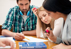 Students working together on a project Royalty Free Stock Photos