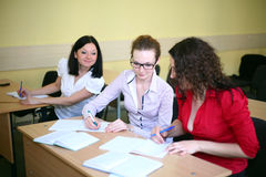Students write off. Students girl blamed for girlfriend class Royalty Free Stock Photo