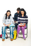 Students writing at course Stock Image