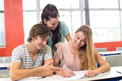 Students writing notes in classroom. Group of college students writing notes in classroom Royalty Free Stock Photography