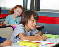Students writing pop quiz Stock Photography