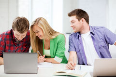 Students writing something at school Royalty Free Stock Images