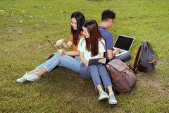 Students young asian together working study. Smiling with tablet,laptop computer at university high school campus,college in summer holiday relaxation stock photo