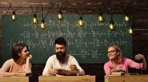 Students, young scientists . Girls, happy students looking with adoration at bearded teacher, lecturer, professor. Students, young scientists. Girls, happy royalty free stock photography