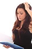 Studentswoman avec le mal de tête Photographie stock libre de droits