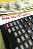 Studera bankinsättninghastigheter Arkivfoto