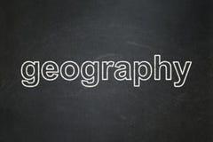 Studera begrepp: Geografi på svart tavlabakgrund arkivbild