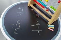 Studera matematik med kulrammet Royaltyfri Bild