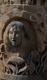 Studie av utomhus- ansikts- stenskulptur Arkivfoton